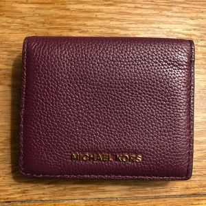 plum two tone leather Michael Kors wallet.